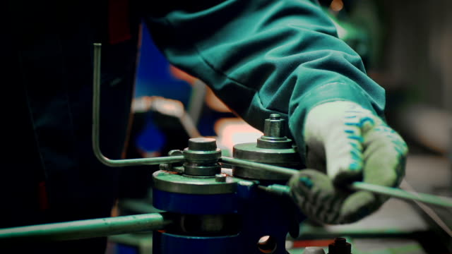 Bending the pipes in the factory. Pipe bending machine video