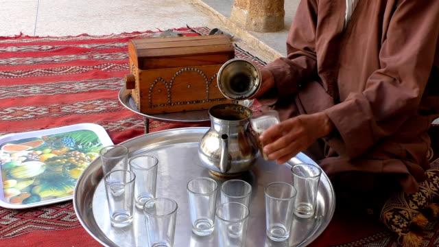 Berber man making tea video