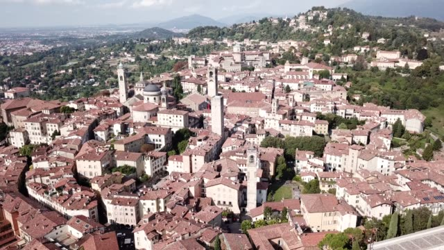 bergamo, italy. amazing drone aerial view of the old town. landscape at the city center, its historical buildings and the towers - lombardia video stock e b–roll