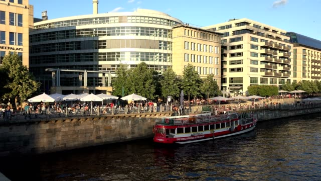 Berlin along the river spree showing diners enjoying the evening circa 20th July