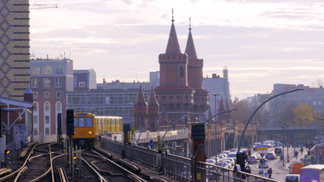 Berlin Attractions - Subway Crossing the Iconic Oberbaum Bridge 4K video of a subway train crossing one Berlin's most famous and iconic tourist attractions: the Oberbraum Bridge. The Oberbraum Bridge crosses over the river Spree and connects the hip and cool neighborhood of Kreuzberg with Friedrichshain. vintage architecture stock videos & royalty-free footage