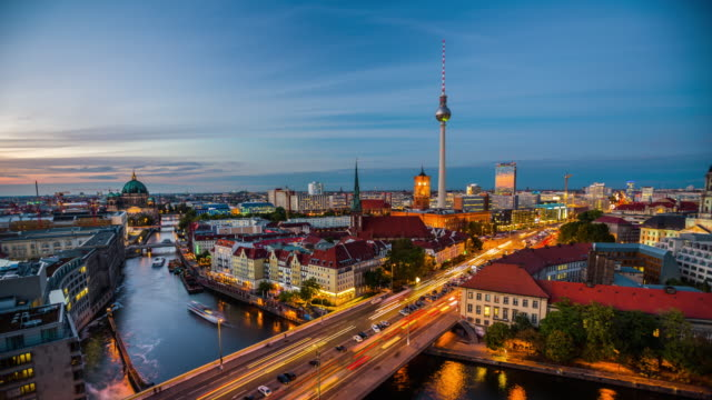 Berlin Cityscape - Day to Night Time Lapse Dusk to night time lapse of Berlin skyline. Light trails of traffic on a bridge over the Spree River in the foreground. Television tower and Berlin Cathedral in the background. Germany - Europe european culture stock videos & royalty-free footage