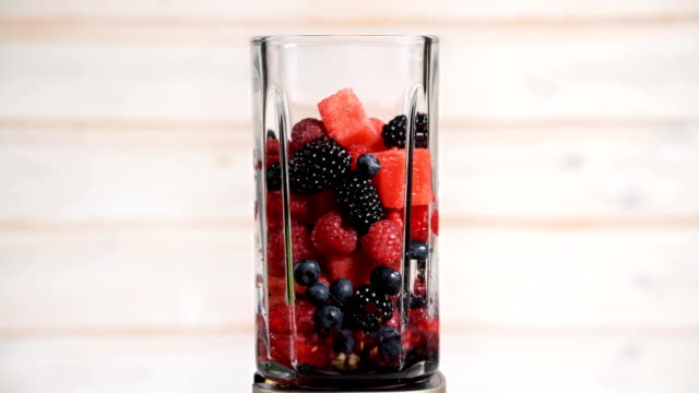 berries appear in a blender video