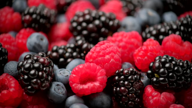 Berries rotation background. Healthy eating, Vegan food, Diet. Raspberry, Blackberry, Blueberry close-up