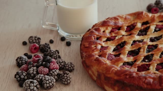 berry cake made by own hands on a wooden background - sweet pie stock videos & royalty-free footage