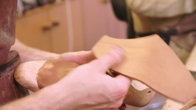Bespoke Shoemaker Measuring And Cutting Leather For Shoe video