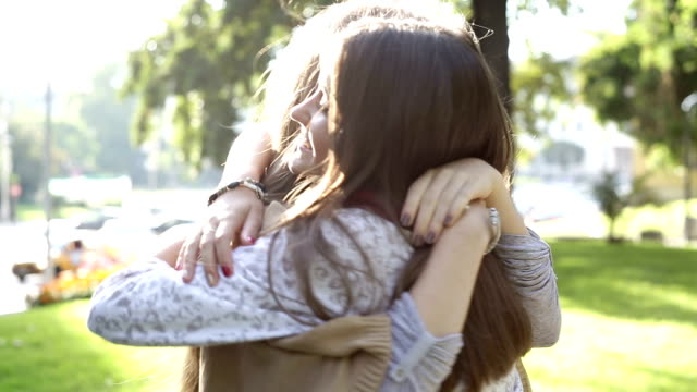 Best friends hugging Two teen girls hugging and smiling eternity stock videos & royalty-free footage