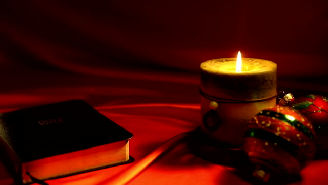 Bible and Candle Video on Red Background video