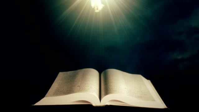 bible with holy spirit 1 - lightning стоковые видео и кадры b-roll