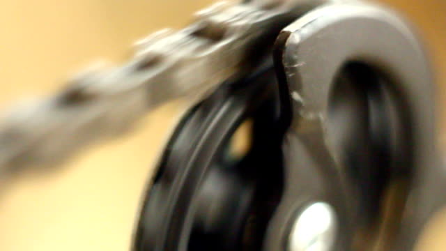 Bicycle gear and chain Macro shot of chain moving on a rear gear of a mountain bike crank mechanism stock videos & royalty-free footage