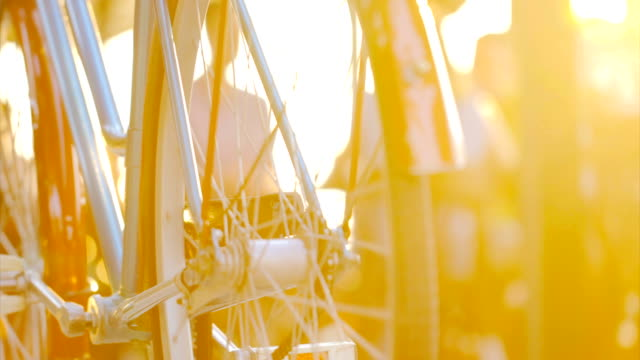 bicycle in the city street at summer sunset. - veicolo a due ruote video stock e b–roll