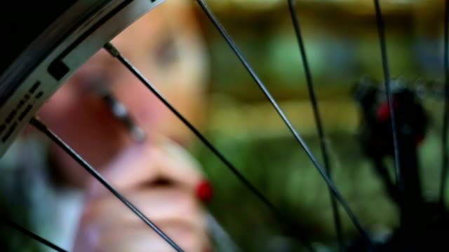 bicycle mechanic repairing on bike in a workshop - sella video stock e b–roll