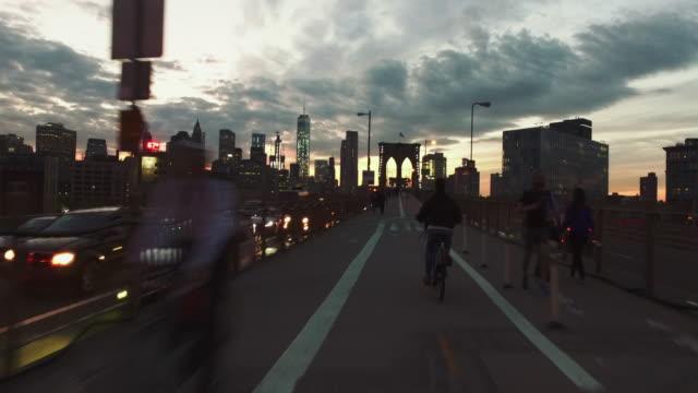 Bicycle POV: night ride on the Brooklyn Bridge, NY city