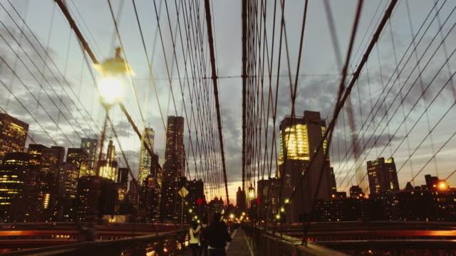 Video Bicycle POV: night ride on the Brooklyn Bridge, NY city
