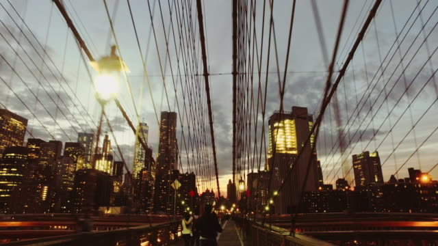 bicycle pov: night ride on the brooklyn bridge, ny city - american architecture stock videos & royalty-free footage