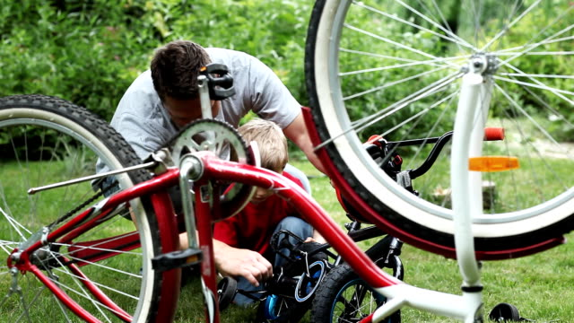 Bicycle Repair Father and Son video