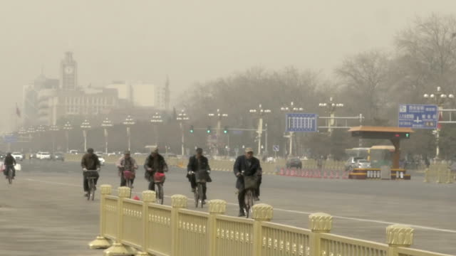 Bicycle riders near Tiananmen Square video