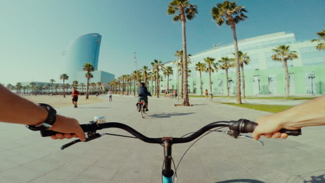 POV bicycle riding in Barceloneta beach during summer vacations POV bicycle riding in Barcelona summer vacations action movie stock videos & royalty-free footage