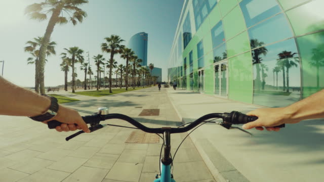 POV bicycle riding in coastal resort summer vacations video
