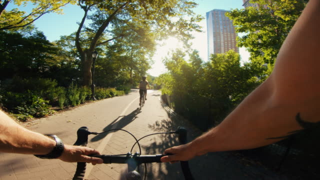 POV bicycle riding: man with road racing bike in New York POV bicycle riding: man with road racing bike in New York action movie stock videos & royalty-free footage