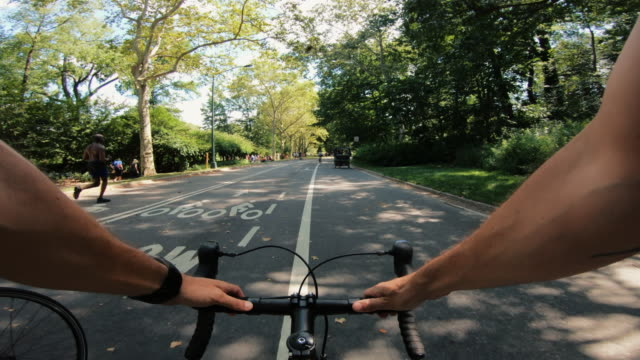 POV bicycle riding: man with road racing bike in New York POV bicycle riding: man with road racing bike in New York handlebar stock videos & royalty-free footage