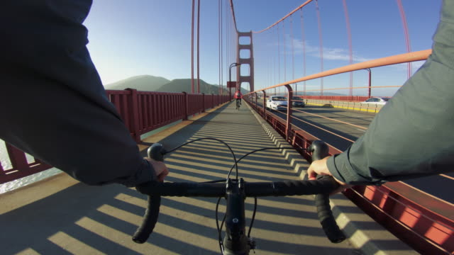 POV bicycle riding: over Golden Gate bridge in San Francisco POV bicycle riding: over Golden Gate bridge in San Francisco action movie stock videos & royalty-free footage