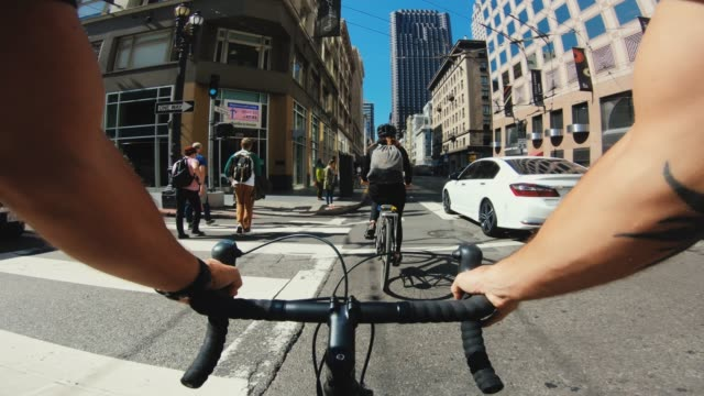 POV bicycle riding: tourists with road racing bike in San Francisco POV bicycle riding: commuter with road racing bike in San Francisco, Financial District handlebar stock videos & royalty-free footage