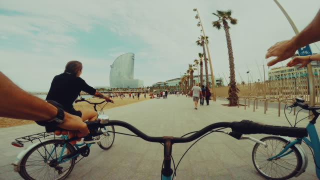 POV bicycle riding with girls: high five and go video