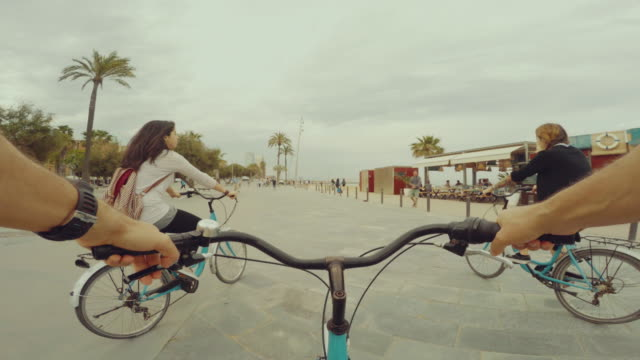 POV bicycle riding with two nice girls video