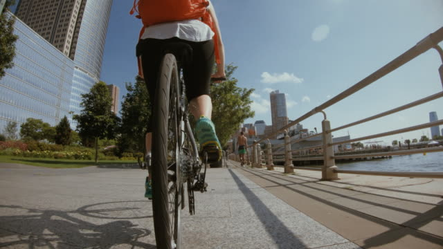 POV bicycle riding: woman with bike in New York POV bicycle riding: woman with bike in New York action movie stock videos & royalty-free footage