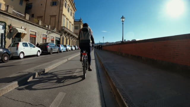 POV bicycle riding: woman with city bike in Florence