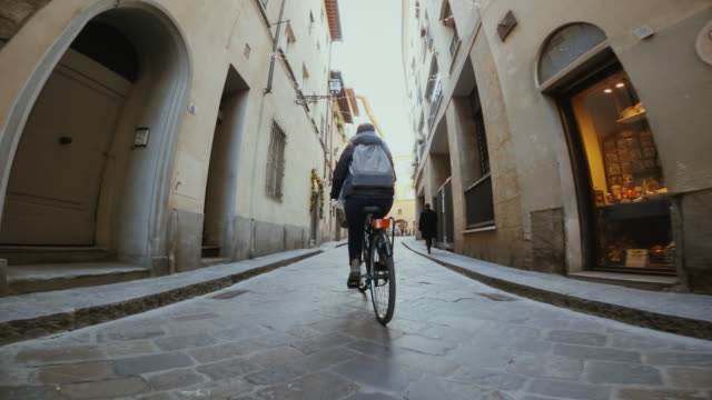 POV bicycle riding: woman with city bike in Florence POV bicycle riding: woman with city bike in Florence action movie stock videos & royalty-free footage