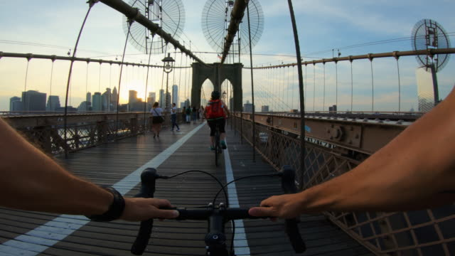 POV bicycle: road racing bike on Brooklyn Bridge POV bicycle: road racing bike on Brooklyn Bridge action movie stock videos & royalty-free footage