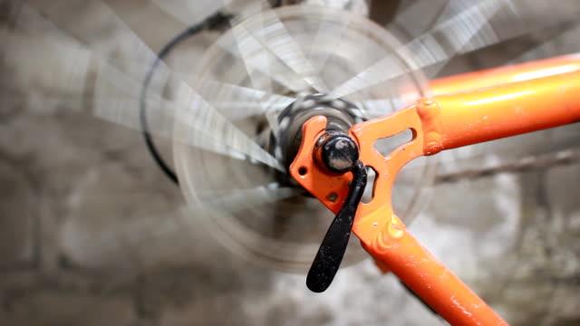Bicycle wheel rotating orange bicycle dirty wheel rotating closeup wheel stock videos & royalty-free footage