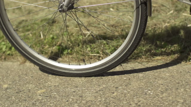SLOW MOTION: Bicycle wheel Slow motion shot of a bicycle wheel wheel stock videos & royalty-free footage