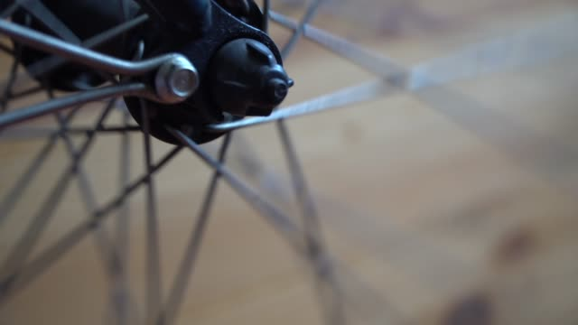 Bicycle wheel with spokes spinning moves