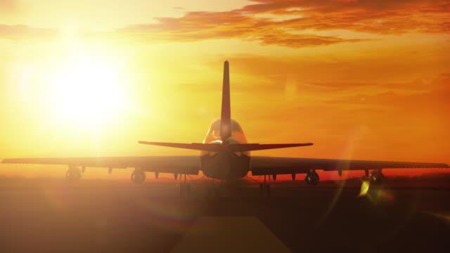 Big airliner landing on runway in sunset video
