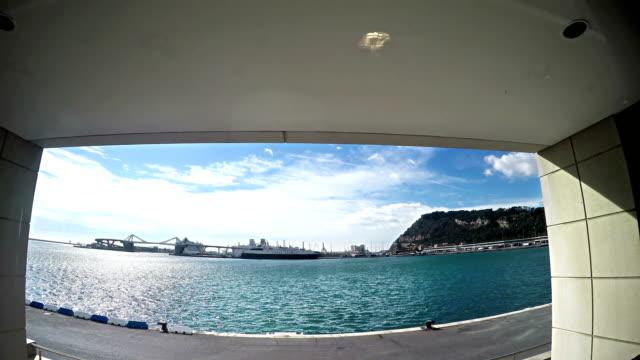Big beautiful luxury yacht sail from port Barcelona, Rambla de Mar, Mediterranean Sea, panning shot video