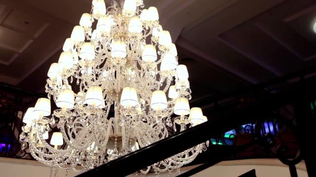 big beautiful vintage chandelier, classic chandelier, beautiful decoration - stile del xix secolo video stock e b–roll