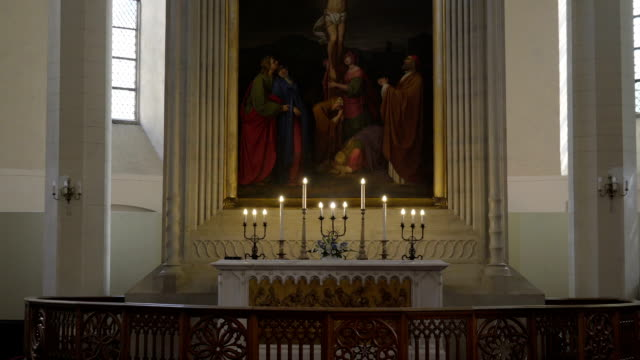 Big candles lighted on the altar video