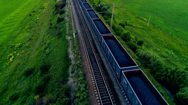 Big cargo train transporting coal. Aerial shot. Close-up. Big cargo train transporting coal. Aerial shot. 4K coal stock videos & royalty-free footage