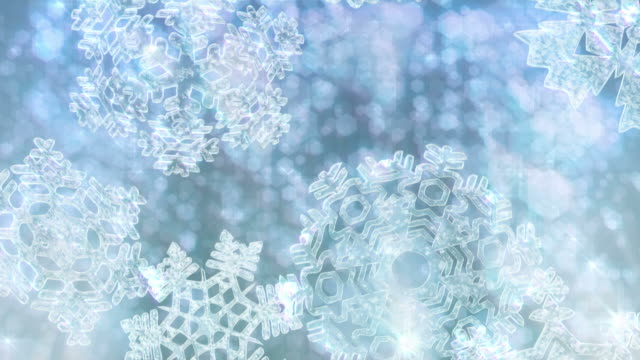 Big Christmas snowflakes falling with sparkly defocused background video