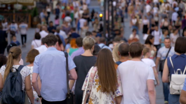 a big crowd of people walking down the street. out of focus - city walking background video stock e b–roll