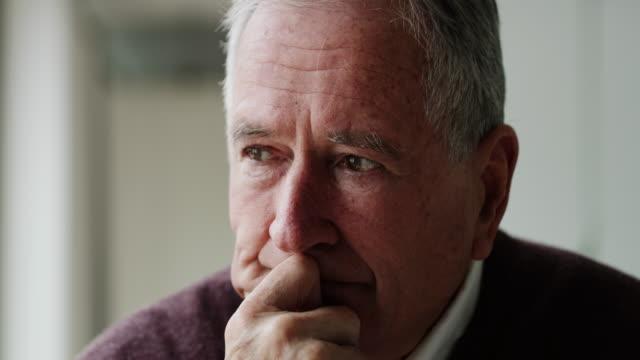 vídeos de stock e filmes b-roll de big decisions require big consideration - old men window