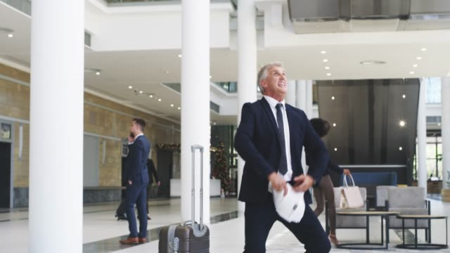 Big effort, big results 4k video footage of a mature businessman throwing his paperwork in the air after receiving good news on his smartphone good news stock videos & royalty-free footage