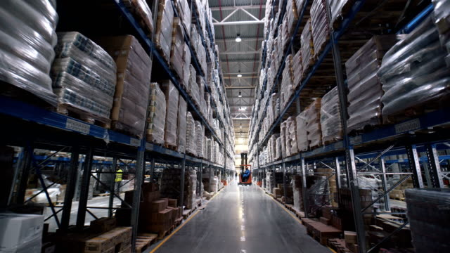 big factory warehouse. store Aisles. Camera travels inside a large store video