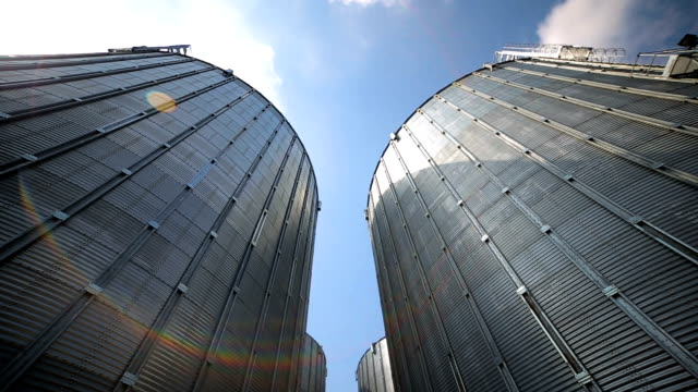 big group of grain dryers complex for drying wheat. modern grain silo - agricultural machinery stock videos & royalty-free footage