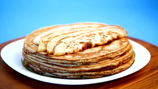 big high stack of thin pancakes in a plate - piattino video stock e b–roll
