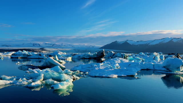 Big Icebergs Drifting and Melting Big Icebergs Drifting and Melting in Glacier Lagoon icecap stock videos & royalty-free footage