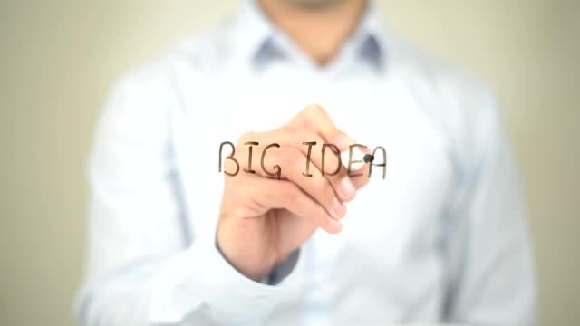 Big Idea, Man writing on transparent screen video